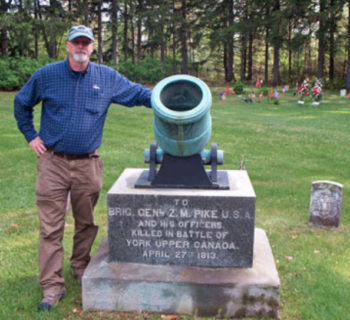 Tom with Pike Gravestone Sackets Harbor, NY